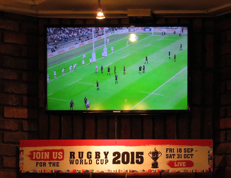 Watching the Rugby World Cup at the Central Bar in Carrickfergus, a small town on the Coastal Causeway route in Northern Ireland, UK