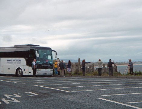 Bus Tour 'Photostop' at Dunluce Castle ruins in Northern Ireland, UK