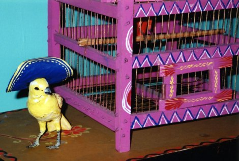 bright Mexican canary and cage