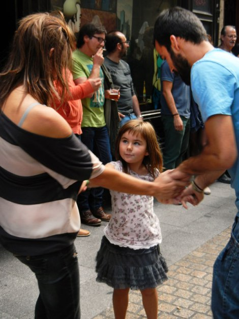 A family dancing at the Bilbao street party on the 'Dia de Fiesta Nacional''