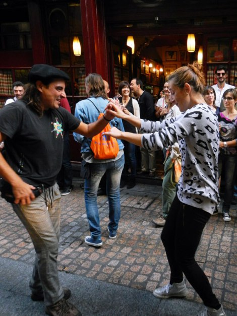 A family dancing at the Bilbao street party on the 'Dia de Fiesta Nacional'