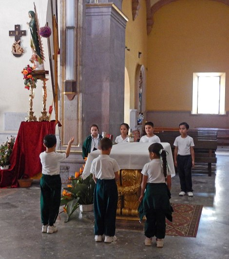 Children practising 'posadas', a Christmas pageant, in the church in Mascota, Mexico