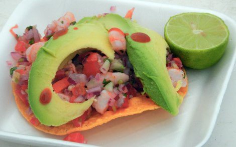 Shrimp ceviche on a tostada with extra lime and hot sauce