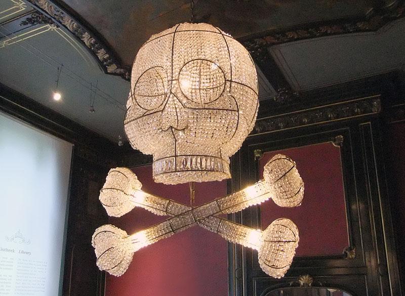 A skull and crossbones chandelier in the Escher Museum in Den Haag, Holland