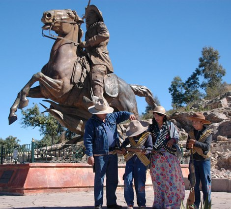 A family of revolutionaries get ready to pose in front of a statue of Pancho Villa on the Cerro de la Bufa, the highest point in Zacatecas, Mexico