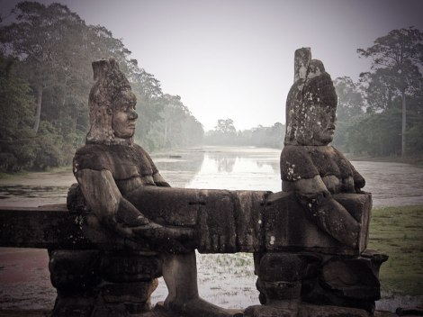 Angkor Wat bridge in the early morning mist