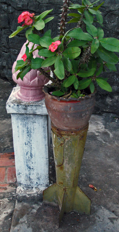 Recycled bomb acts as a planter in a monastery in Laos