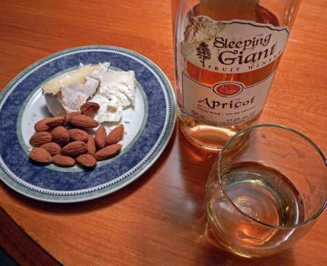 Apricot wine with almonds and Camembert cheese