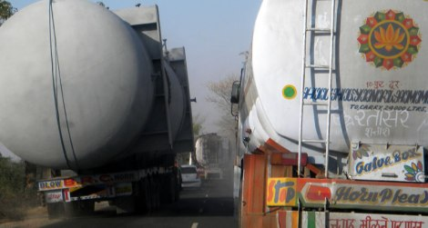 'Hazardous Chemical' carrying monstrosity squeezing its way through traffic on a two-lane highway in India