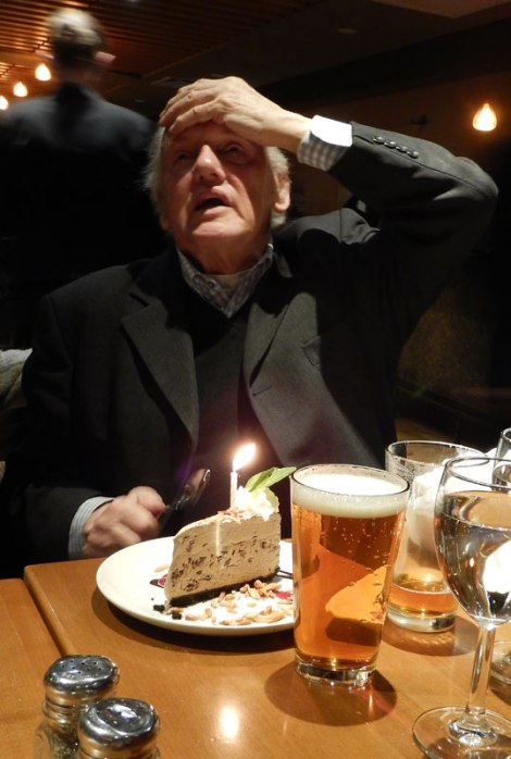 Trying to think of what to wish for on his 74th birthday in Kit's Boathouse