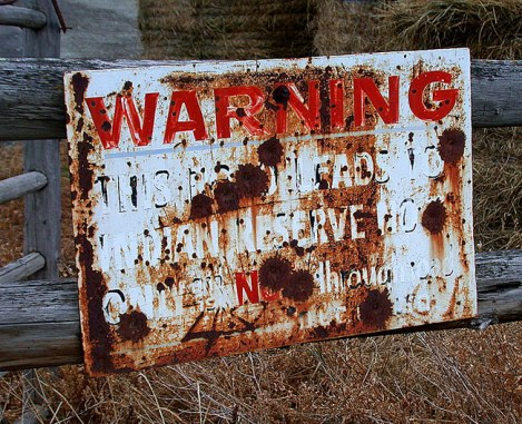 Bullet-Riddled Warning Sign up in BC's Cowboy Country