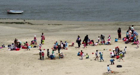 Kids playing on the beach at Cap Hornu on the Normandy Coast of France