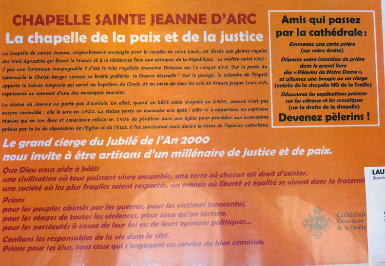 A sign containing information about Joan of Arc in the Lille Cathedral in France