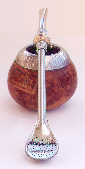 Mate, the favourite drink in Argentina, comes with a special strainer spoon and a cup made from a gourd and rimmed with silver.