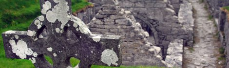 Sunken Church with Celtic Cross in a cemetery on the Aran Island of Inisheer in Ireland
