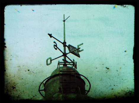Weather vane on a lighthouse in Spain