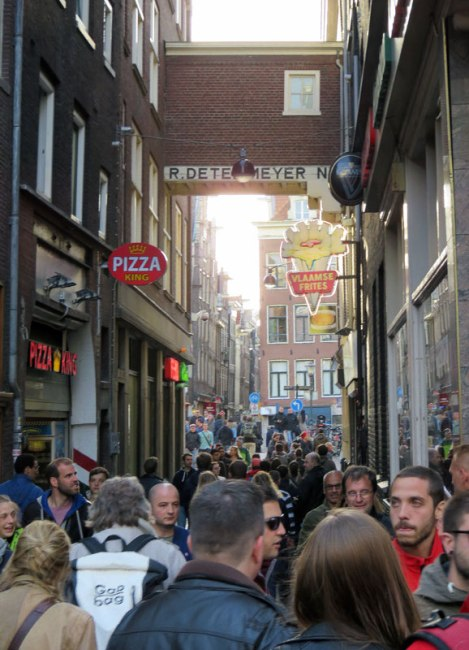 Crowded pedestrian walking street in Amsterdam, Holland