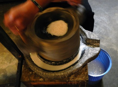 We learned the traditional way of grinding rice in Ms. Vy's Cooking Class in Hot An, Vietnam