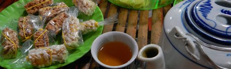 At the snack factory on the Mekong River: Tea with sweets
