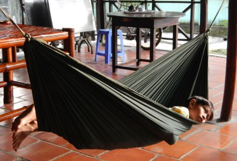 Early morning in a hammock at our Homestay on a farm on the Mekong River in Vietnam
