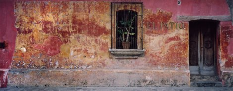 The faded plaster wall of El Patio in Antigua, Guatemala