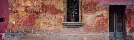 The faded plaster wall of El Patio in Antigua, Guatemala