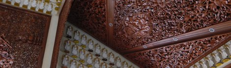 Intricately carved wood ceiling in a temple in Penang, Malaysia
