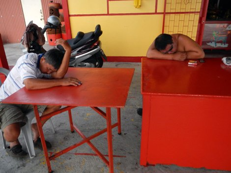 Sleeping men in Jetty village in Penang, Malaysia