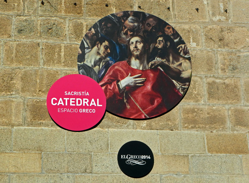 Signage showing the El Greco painting in the Cathedral of Toledo in Toledo, Spain