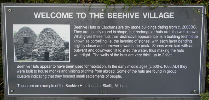 Sign explaining the 'Beehive' huts