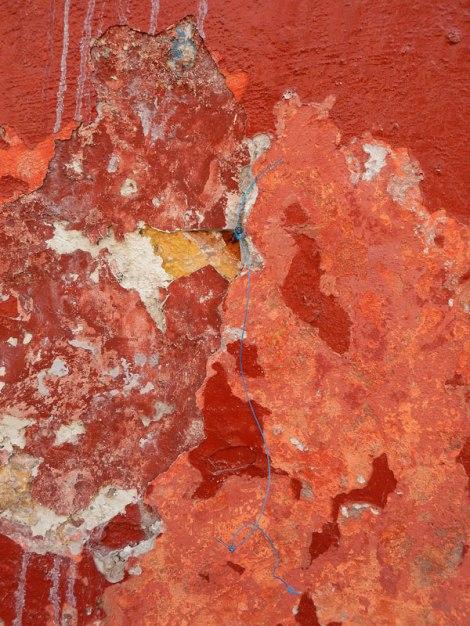 Textured orange wall in Puebla