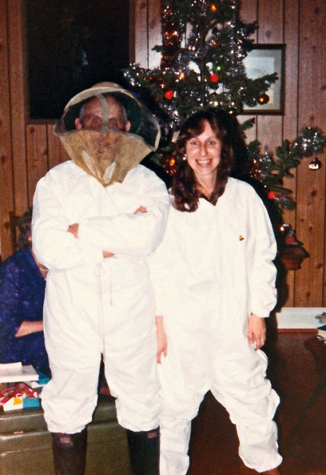Dad and I in beekeeper suits Xmas 84