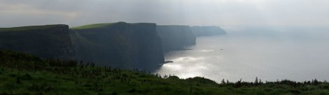 Sun rays pour from the sky on the Cliffs of Moher near Doolin in Ireland
