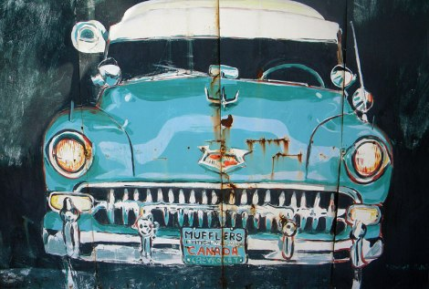 Painting of a 'rusty' car on a garage gate in White Rock, Canada