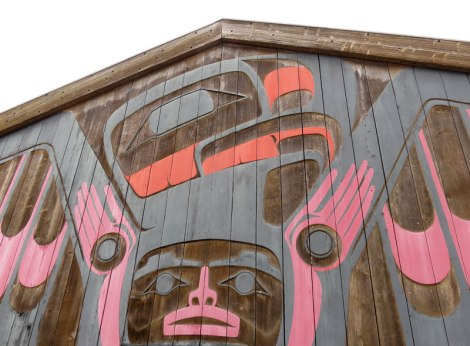 Mural of First Nations art carved on a gallery in Tofino on Vancouver Island, Canada
