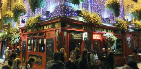 The Temple Bar all lit up at night, one of those pubs we were warned about by the locals as charging twice as much for a beer and not being very authentic.