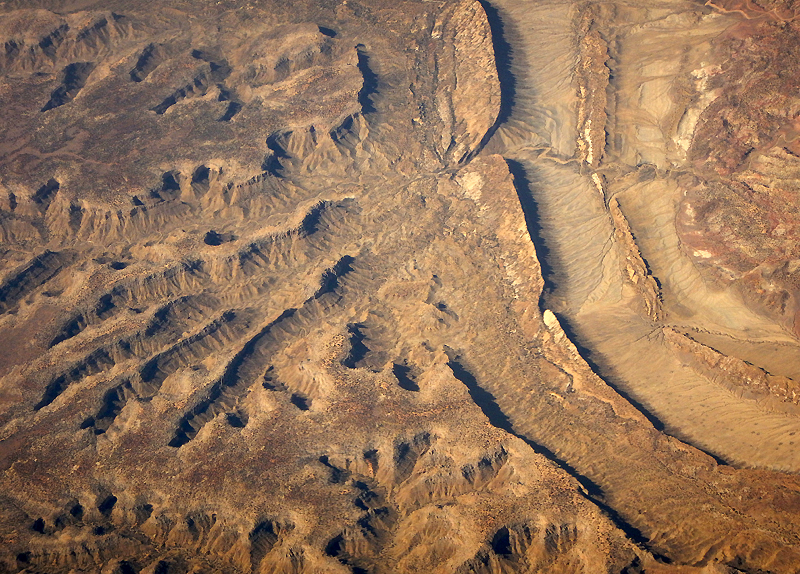 Aerial of desert ridges and a dry riverbed