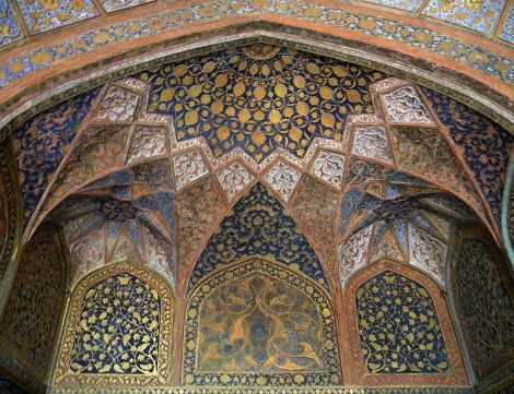 Richly painted ceiling on a wall at Akbar's Mausoleum in Agra, India