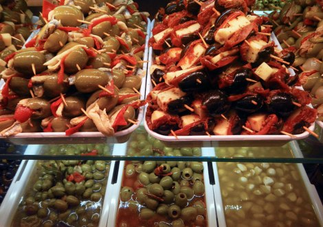 Olives and tidbits for sale at San Miguel Market, Madrid's 'Gastronomic Temple' in Spain