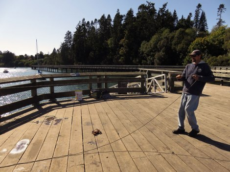 On Sooke's long boardwalk some crab catching