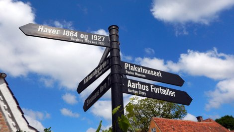 Directional signs to 1864 and 1927 in Aarhus old village, Den Gamle By, in Denmark