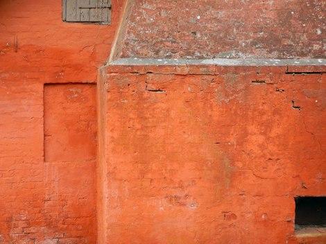 Orange walls of the Nordenbro blacksmith shop in Denmark