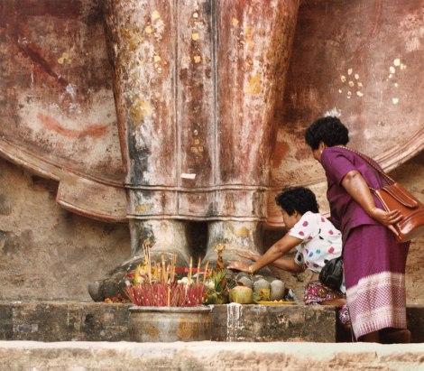 Worshipping Buddha in Sukothai, Thailand