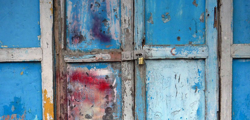 Weathered blue doors with a modern lock at Inle Lake in Myanmar