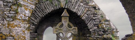 A Celtic cross at Timoleague Friary Ruins in Ireland