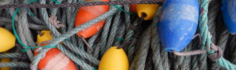 Colourful buoys caught up in ropes for fishing in Luarca, Spain.