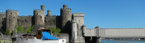 View of Conwy Castle in Wales from the beach beside the castle