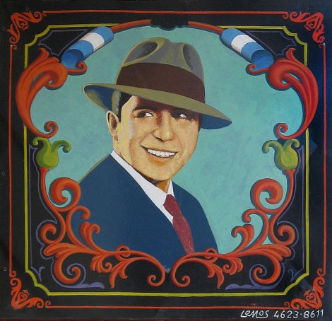 Gardel was the man who first put words to tangos creating a sensation around much of the Americas and Europe. This great tango singer shows up on this decorative painted filete mural in Buenos Aires