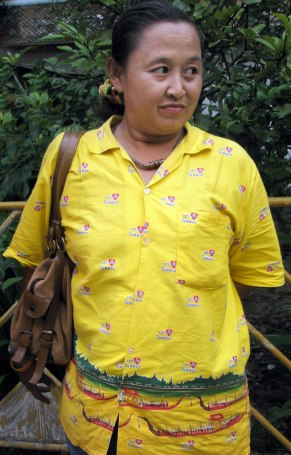 Maryjane, dressed in a special yellow shirt that commemorates the king's birthday and the Royal Barge procession