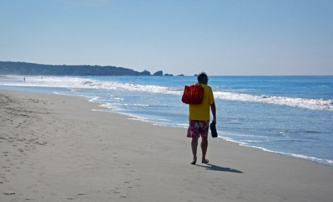 Al wandering down the main beach in the morning at Puerto Escondido, Mexico